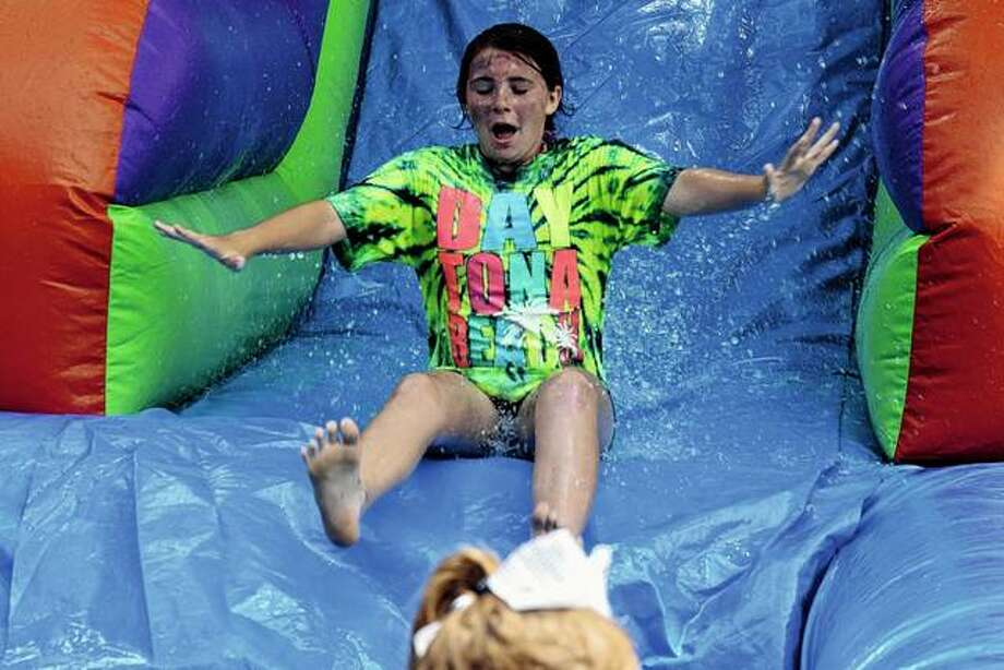 The water-slide inflatable proves a popular feature of the 2018 Fourth of July Blast at Nichols Park. The free event returns to the park today. Photo: Journal-Courier File