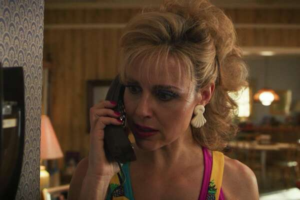 Karen Wheeler, Mike's mom (actress Cara Buono), forgets that when you spy on someone via phone extension you need to stay quiet.