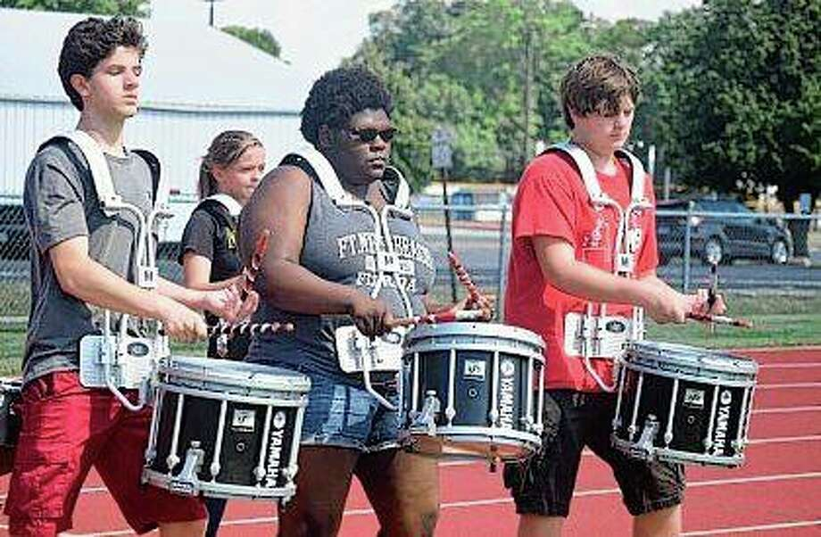 Jacksonville High School Drumline members Nate Collen (from left), Jolene Cox and Caleb Provo practice Tuesday at Illinois College. Photo: Samantha McDaniel-Ogletree | Journal-Courier
