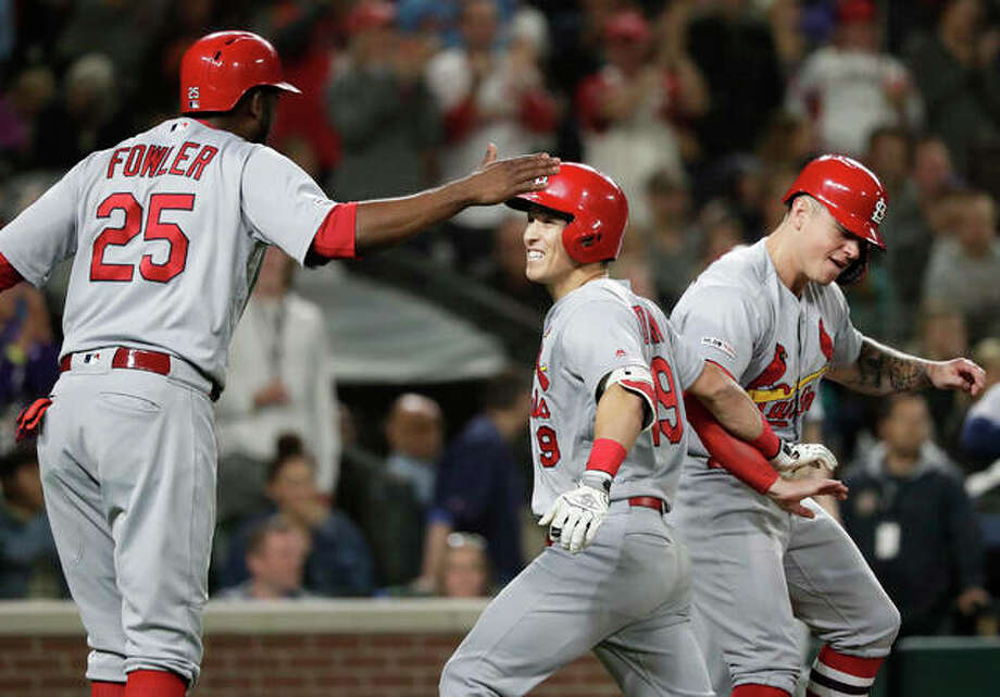 The Cardinals' Tommy Edman (center) is congratulated by Dexter Fowler (25) and Tyler O'Neill after his three-run home run against the Mariners during the ninth inning Wednesday night in Seattle. Photo: Associated Press