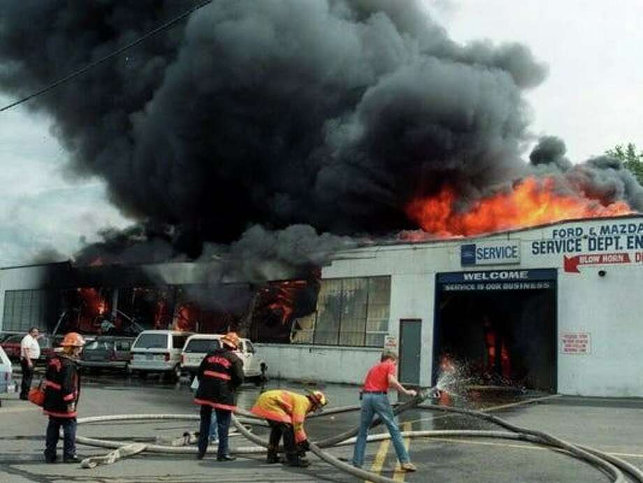 A fire ripped through a Ford dealership in New Jersey on July 1, 1988. Thirty-one years later, it is still a reminder for local firefighters in Connecticut. Photo: Contributed Photo / Shelton Fire Department