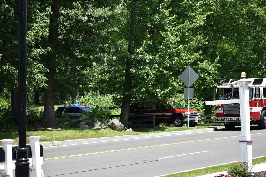First responders block off public access to a field on Reserve Road following an officer-involved shooting on July 3, 2019. Photo: Kendra Baker / Hearst Connecticut Media
