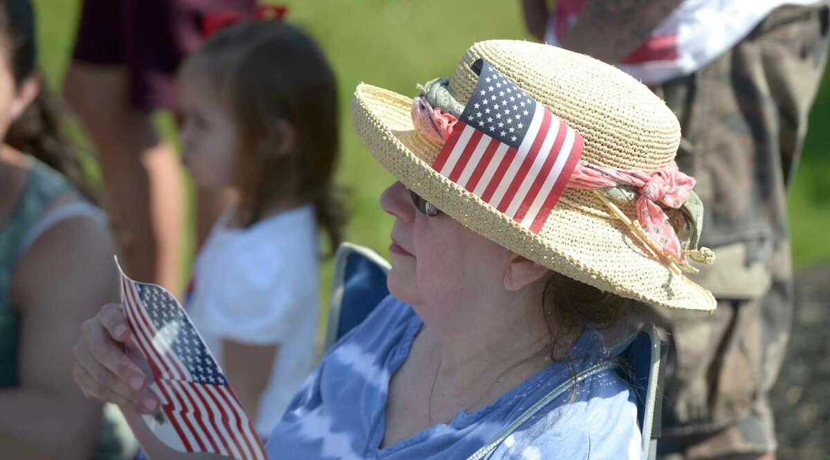 Barbara Scrima, of New Fairfield, watches the New Fairfield Lions Club annual Independence Day parade. This years theme was