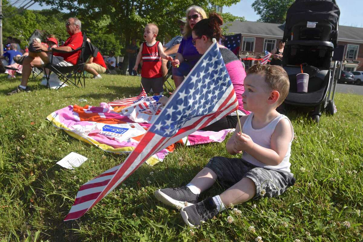 Kingston Pacific, 2, of Danbury, waits for the start of the New Fairfield Lions Club annual Independence Day parade. This years theme was