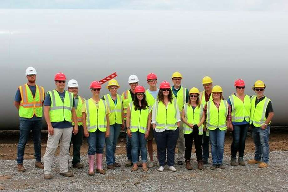 Residents, students and construction workers take a tour of the Cross Winds Energy Park in Unionville. The park's third phase is currently under construction. (Robert Creenan/Huron Daily Tribune)