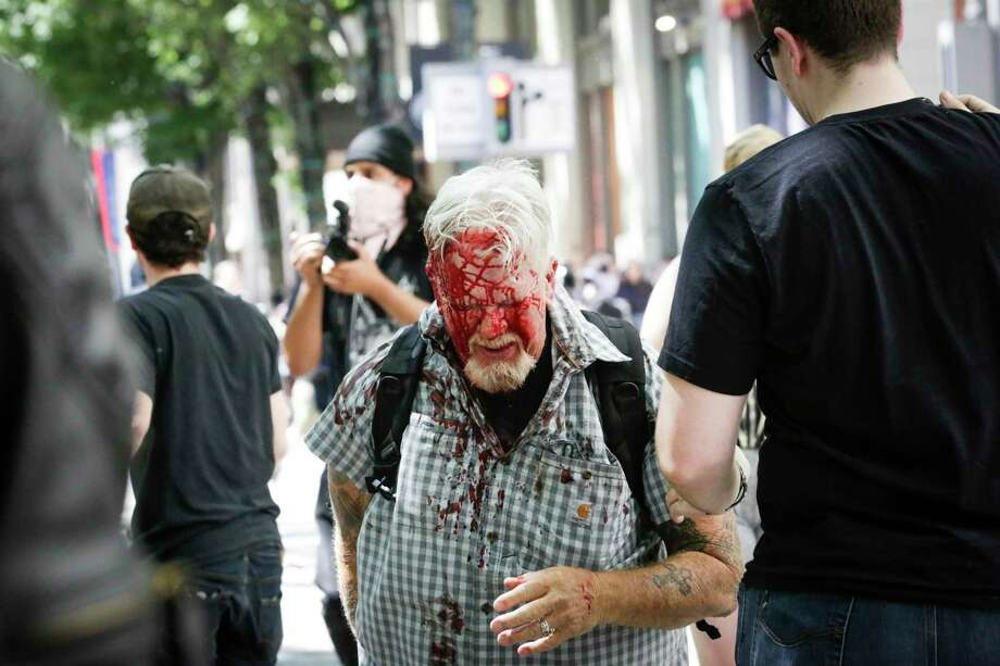 PORTLAND, OR - JUNE 29: (EDITORS NOTE: Image contains graphic content.)  The Rose City Antifa brutally attacks an unidentified right aligning man at Pioneer Courthouse Square on June 29, 2019 in Portland, Oregon. Several groups from the left and right clashed after competing demonstrations at Pioneer Square, Chapman Square, and Waterfront Park spilled into the streets. According to police, medics treated eight people and three people were arrested during the demonstrations. (Photo by Moriah Ratner/Getty Images) Photo: Moriah Ratner, Stringer / Getty Images / 2019 Getty Images