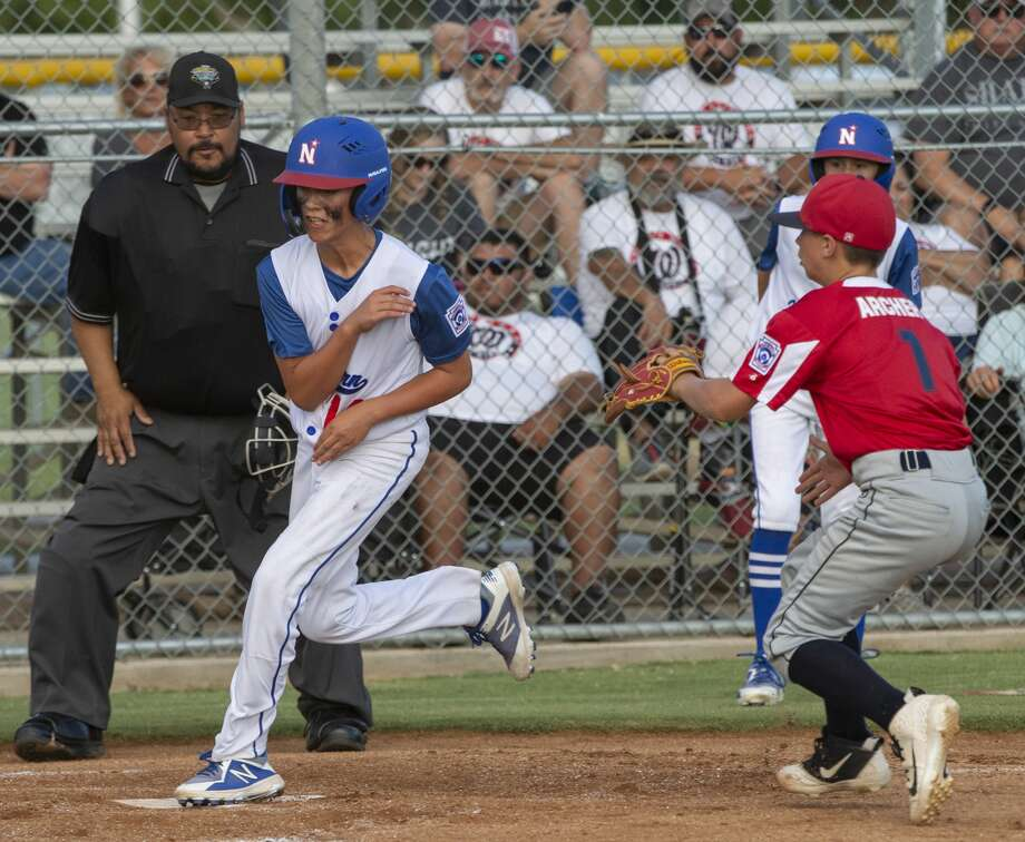 Midland Northern's Ean Shadden scores on a pass-ball as Lubbock Western's Cooper Archer comes to cover the plate 07/03/19 in the 12U Section 1 tournament at Bulter Park. Tim Fischer/Reporter-Telegram Photo: Tim Fischer/Midland Reporter-Telegram