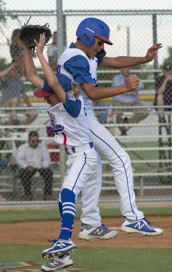 Midland Northern's Crue Collie celebrates with Aiden Serrano after scoring 07/03/19 as they take on Lubbock Western in the 12U Section 1 tournament at Bulter Park. Tim Fischer/Reporter-Telegram Photo: Tim Fischer/Midland Reporter-Telegram