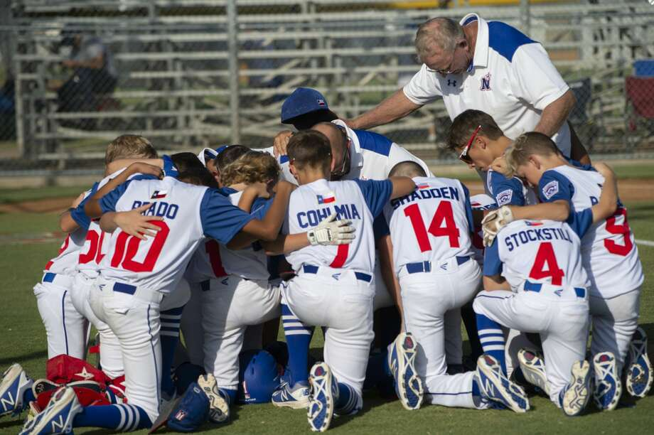 Midland Northern teammates and coaches gather to pray 07/03/19 before they take on Lubbock Western in the 12U Section 1 tournament at Bulter Park. Tim Fischer/Reporter-Telegram Photo: Tim Fischer/Midland Reporter-Telegram