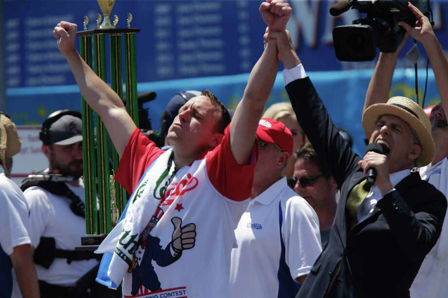 NEW YORK, NY - JULY 04:  Joey Chestnut reacts after he wins the annual Nathan's hot dog eating contest on July 4, 2019 in New York City. Nathan's held its first hot dog eating contest in Coney Island on July 4, 1916. Photo: Kena Betancur, Getty Images / 2019 Getty Images