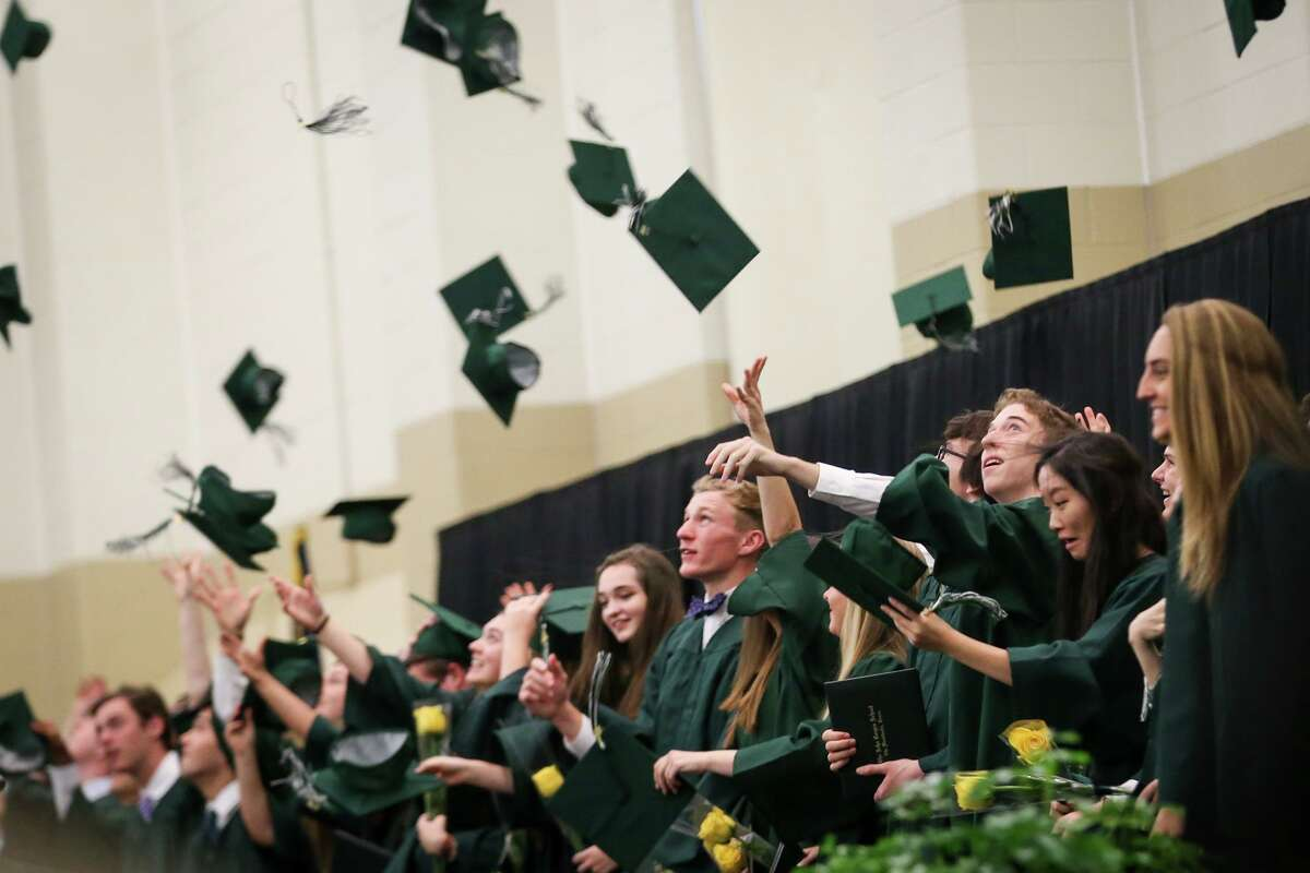 The John Cooper School graduates toss their caps during the commencement ceremony, May 26, 2017. A reader is ashamed a high school diploma is not enough to prove college readiness in Texas.