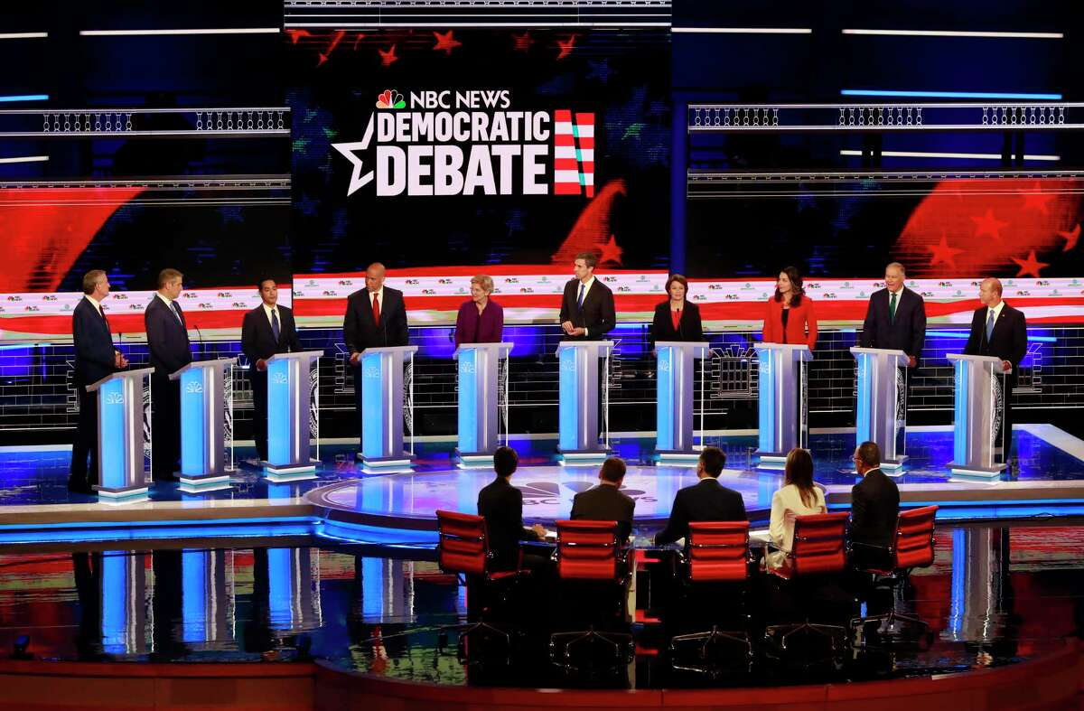 Democratic presidential candidates, left to right, Democratic presidential candidate New York City Mayor, Bill de Blasio, . Rep. Tim Ryan D-OH, former Housing Sec. Julian Castro, Sen. Cory Booker D-NJ., Sen. Elizabeth Warren, D-Mass., former Rep. Beto O'Rourke, D-Tex., Sen. Amy Klobuchar, D-MN. , Rep. Tulsi Gabbard, D-HI., Washington Gov. Jay Inslee, and former U.S. Rep. John Delaney (MD), listen to a question during the Democratic primary debate hosted by NBC News at the Adrienne Arsht Center for the Performing Art, June 26 in Miami.