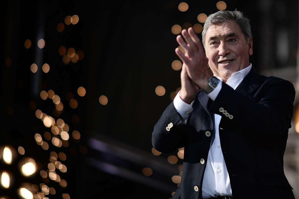 Belgian legend Eddy Merckx applauds during the team presentation ceremony at the Grand-Place - Grote Markt Square in Brussels on July 4, 2019, two days prior to the start of the 106th edition of the Tour de France cycling race. - On Saturday, July 6, the 106th edition of the Tour de France will start with a 194.5km stage in the region of Brussels, 100 years after the introduction of the yellow jersey and 50 years after Belgian legend Eddy Merckx won his first Tour. (Photo by Marco Bertorello / AFP)MARCO BERTORELLO/AFP/Getty Images