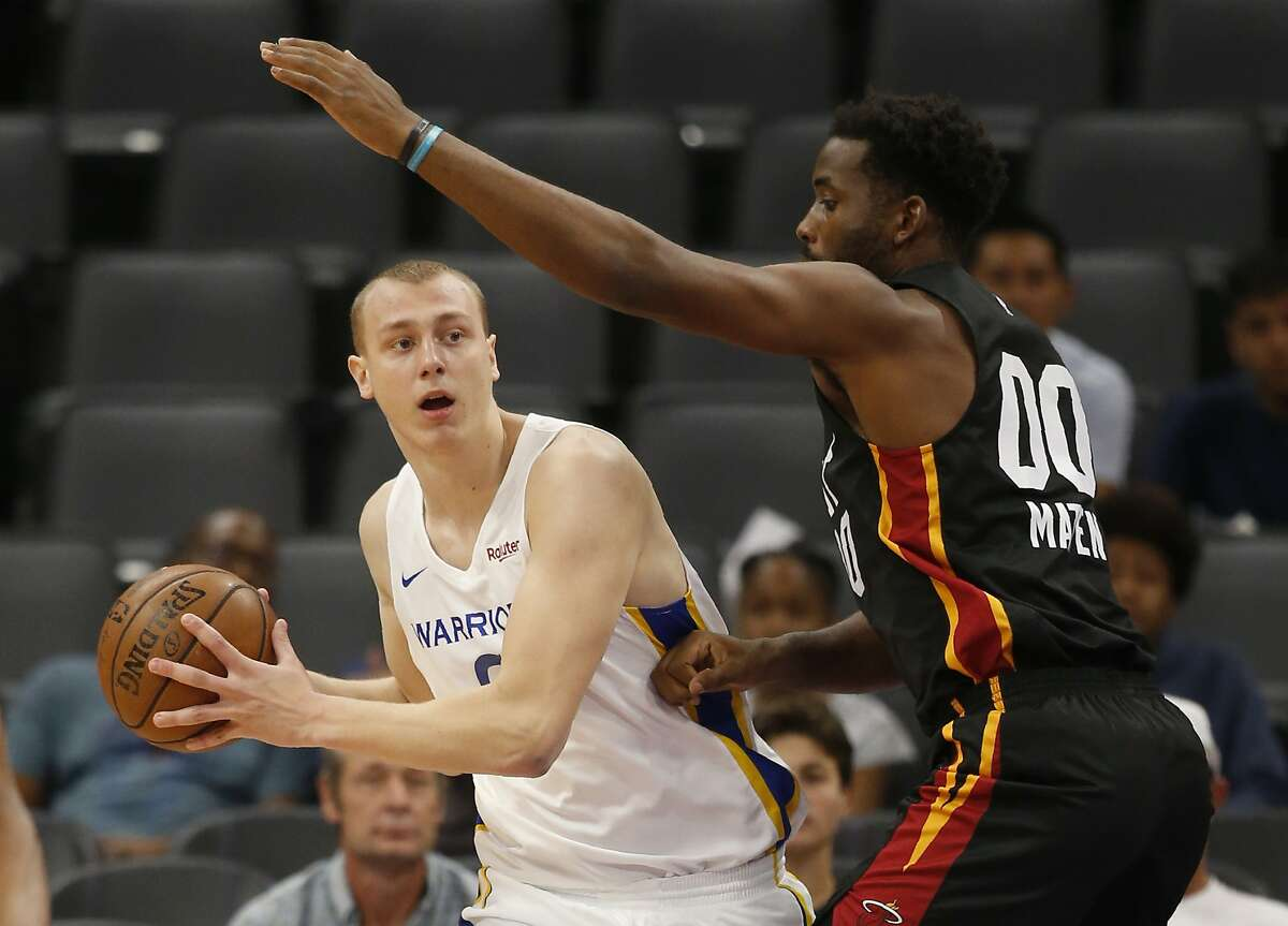 Golden State Warriors forward Alen Smailagic, left, looks to pass against Miami Heat forward Yante Maten during the first half of an NBA basketball summer league game in Sacramento, Calif., Wednesday, July 3, 2019. (AP Photo/Rich Pedroncelli)