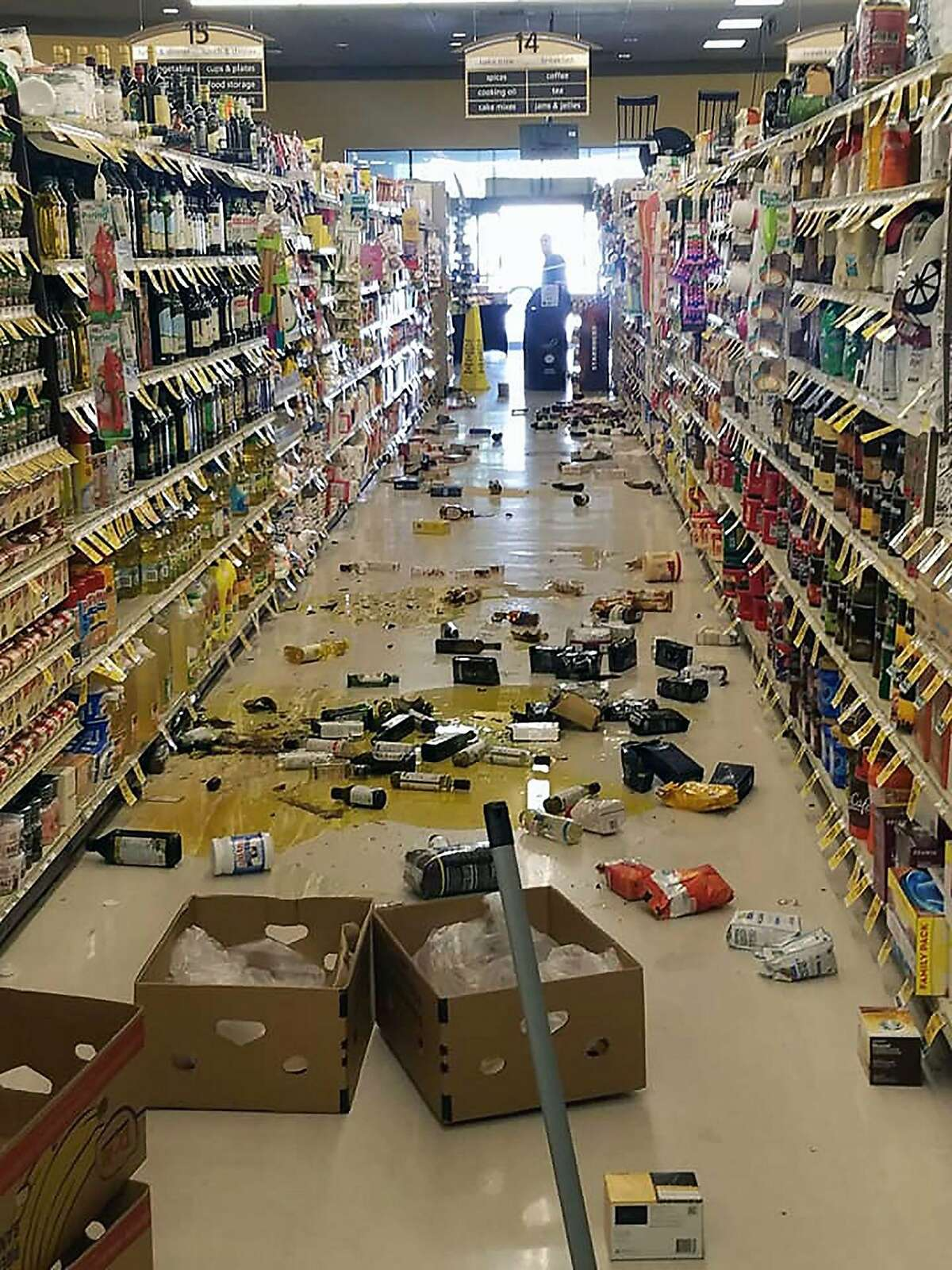 This handout picture obtained courtesy of Rex Emerson taken on July 4, 2019 shows broken bottles and other goods in a store in Lake Isabella after a 6.4 magnitude quake hit Southern California.
