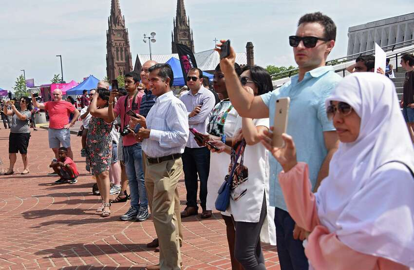 Family members take photos of the Naturalization Ceremony during the 44th annual Independence Day celebration at the Empire State Plaza on Thursday, July 4, 2019 in Albany, N.Y. (Lori Van Buren/Times Union)