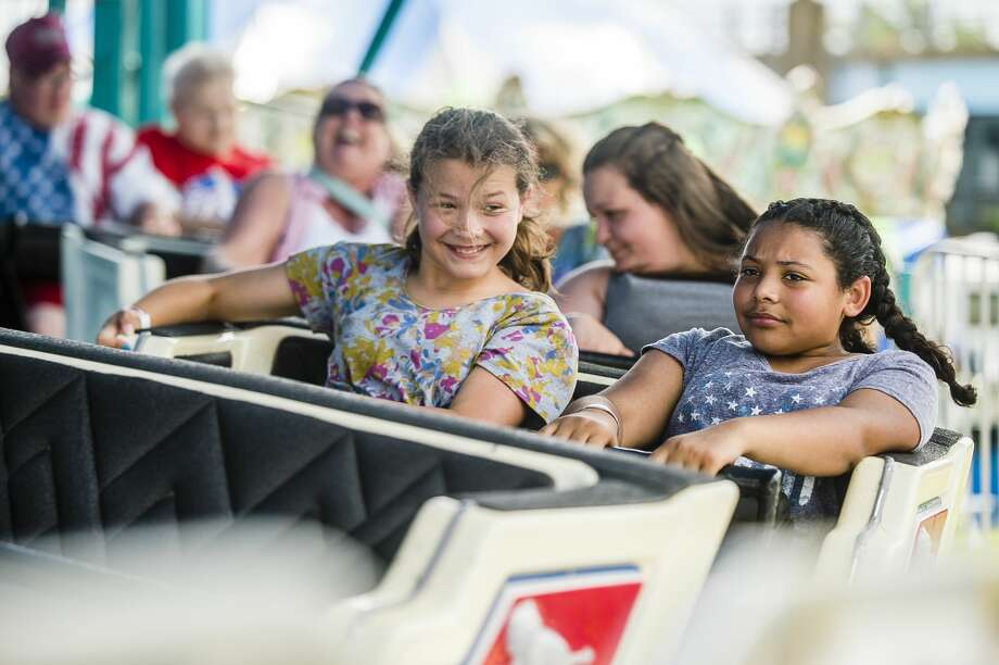Guests enjoy carnival rides, games and refreshments on Thursday, July 4, 2019 at the Skerbeck Family Carnival in Bay City. (Katy Kildee/kkildee@mdn.net) Photo: (Katy Kildee/kkildee@mdn.net)