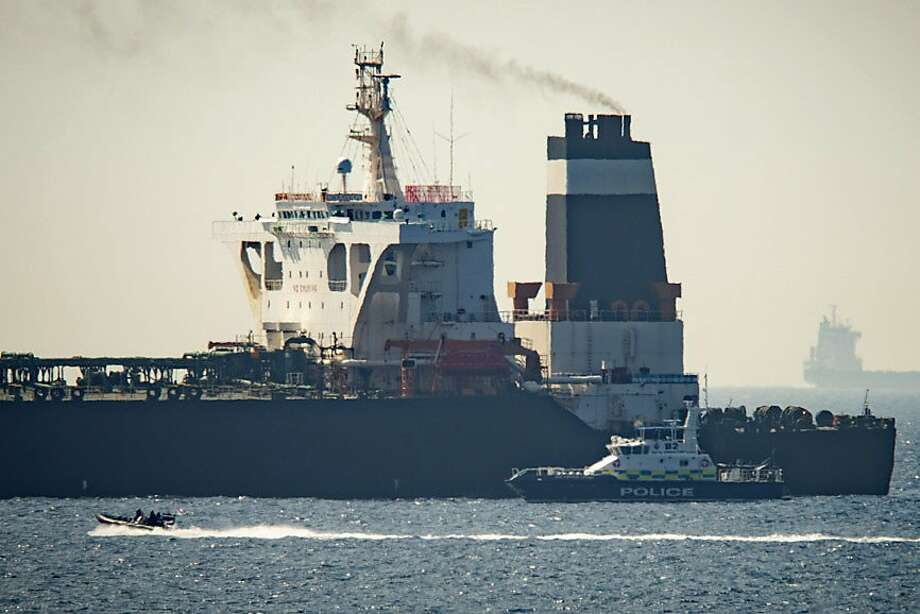 A view of the Grace 1 super tanker i near a Royal Marine patrol vessel in the British territory of Gibraltar, Thursday, July 4, 2019. Spain's acting foreign minister says a tanker stopped off Gibraltar and suspected of taking oil to Syria was intercepted by British authorities after a request from the United States. (AP Photo/Marcos Moreno) Photo: Marcos Moreno, Associated Press