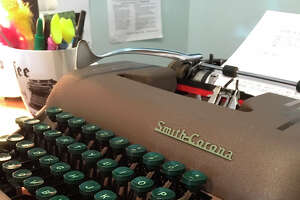 This June 28, 2019 photo shows a working Smith-Corona typewriter from the 1950s, for sale at the Gramercy Typewriter Co. in New York. Vintage typewriters are sent for repair and restoration daily from around the country, the owner of the store says. (Katherine Roth via AP)