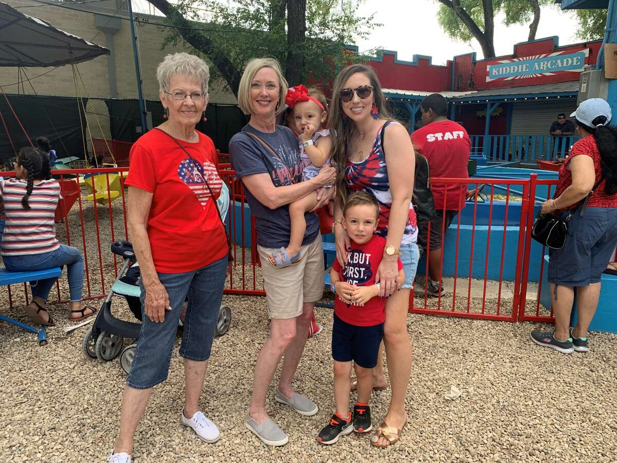 Chelsey Thayer and her familyhave fun at Kiddie Park on its last day at the Broadway location on Thursday.