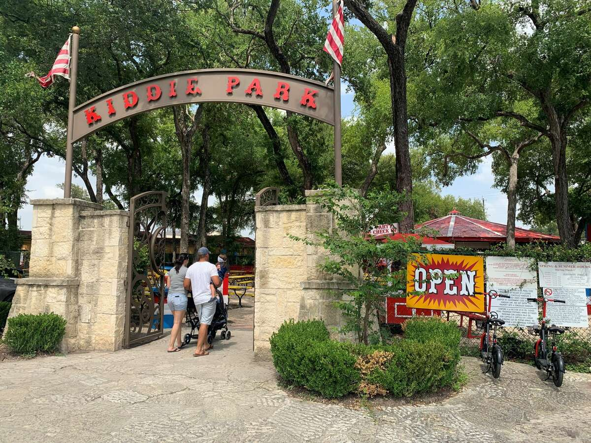 The Hernandez family visit Kiddie Park on its last day at its original location on Thursday.