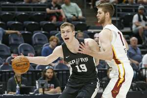San Antonio Spurs Luka Samanic (19) goes to the basket as Cleveland Cavaliers Dean Wade, right, defends in the first half of a NBA Summer League game Monday, July 1, 2019, in Salt Lake City. (AP Photo/Rick Bowmer)