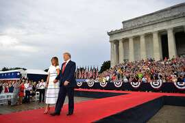 """US President Donald Trump and First Lady Melania Trump arrive to """"Salute to America"""" Fourth of July event at the Lincoln Memorial in Washington, DC, July 4, 2019. (Photo by MANDEL NGAN / AFP)MANDEL NGAN/AFP/Getty Images"""