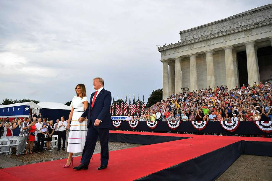 "President Trump and first lady Melania Trump arrive to the ""Salute to America"" Fourth of July event at the Lincoln Memorial in Washington, D.C., which adhered to patriotic themes. Photo: Mandel Ngan / AFP / Getty Images"