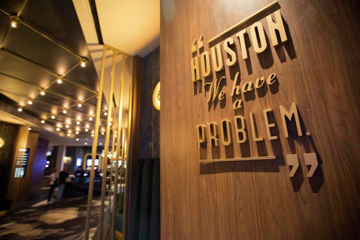 The Star Cinema Grill entrance features recognizable movie quotes in Richmond, Friday, June 21, 2019. Movie theaters in the Houston area are upping the ante of amenities to compete with ever-improving home theater systems.