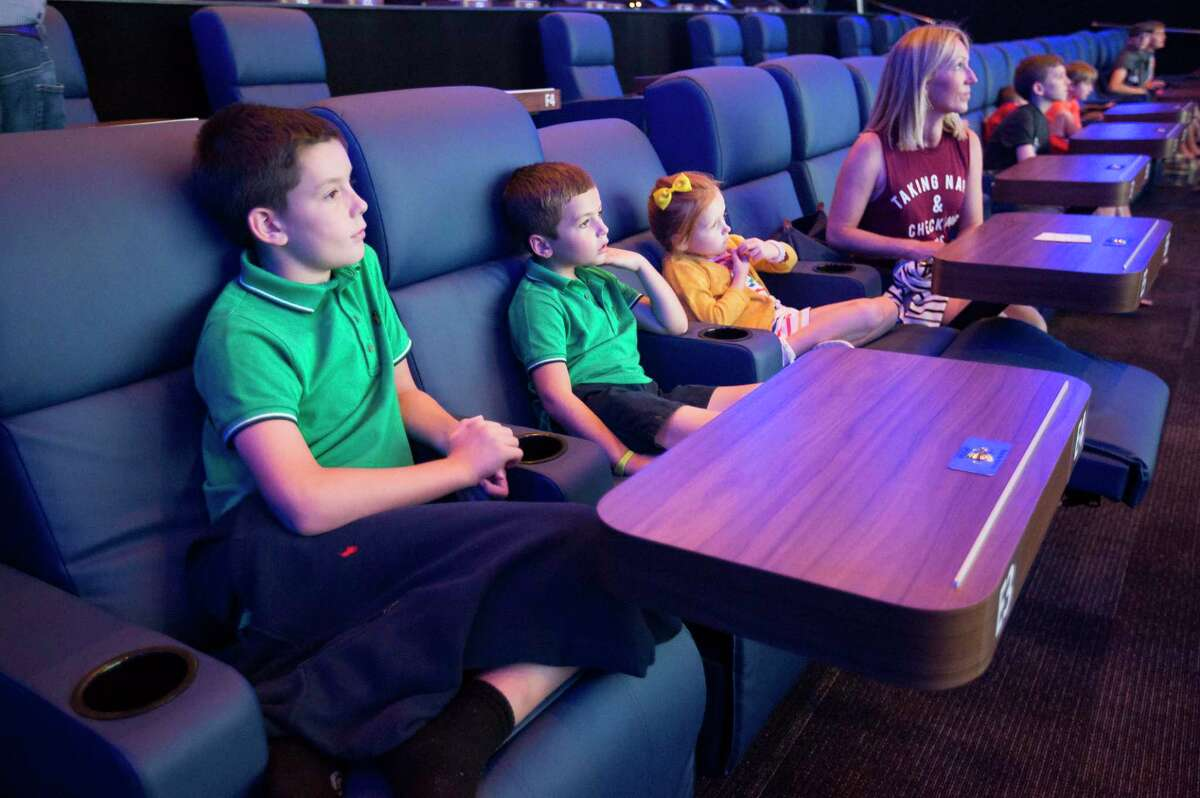 The Tait family from Katy watches the previews before Toy Story 4 on the Star Cinema Grill's Samsung Onyx screen in Richmond, Friday, June 21, 2019. Movie theaters in the Houston area are upping the ante of amenities to compete with ever-improving home theater systems.
