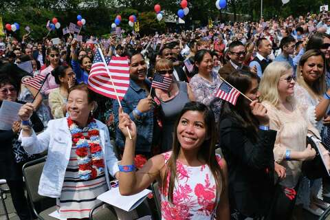 A theme as 500 become US citizens at Seattle Center