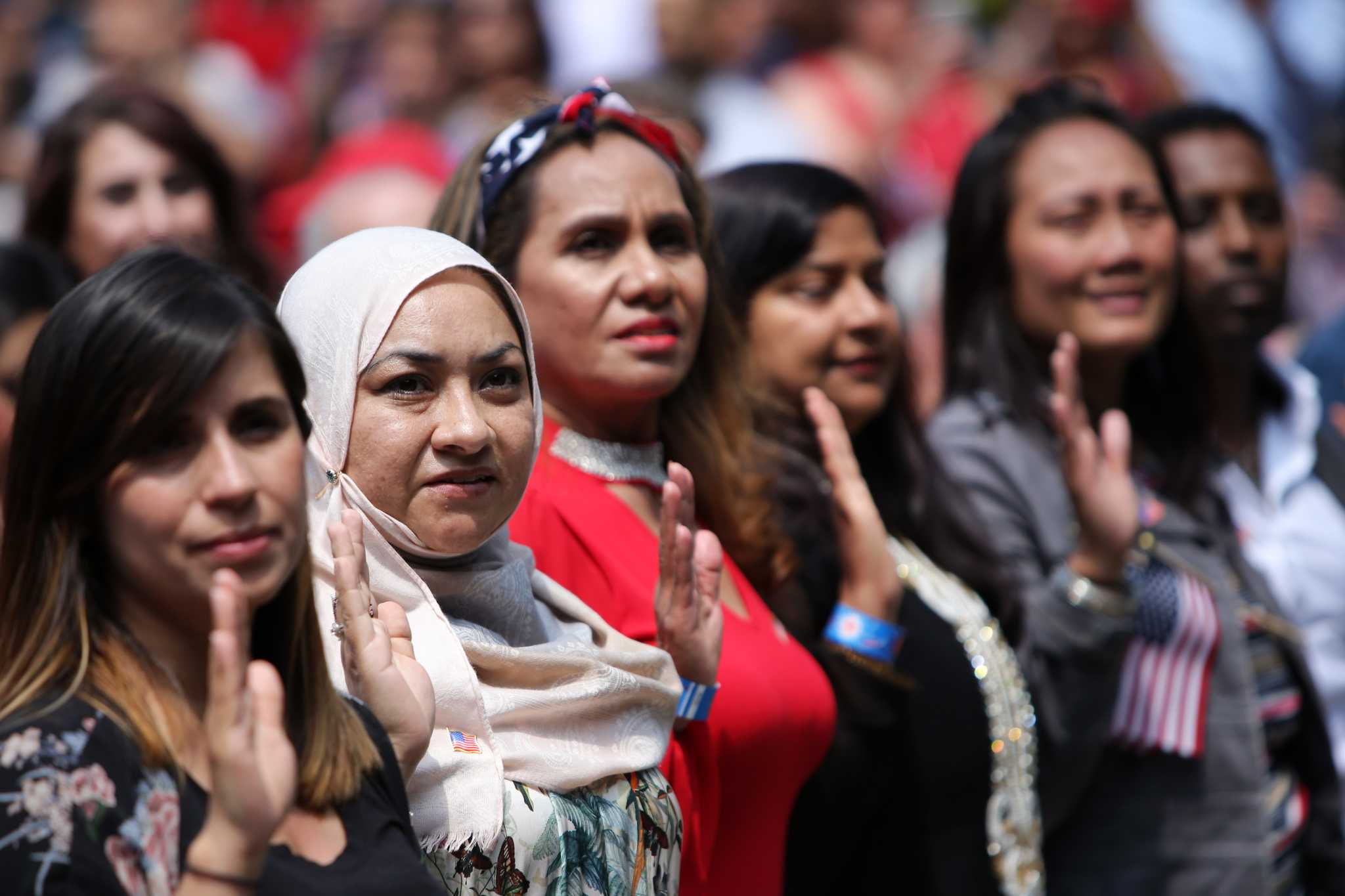 A theme as 500 become US citizens at Seattle Center: Immigrants make America great