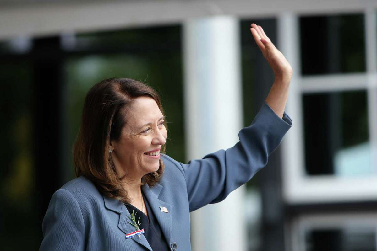 """U.S. Senator Maria Cantwell (D-Wa) waves to the 503 people becoming American citizens during the Independence Day Naturalization Ceremony in Seattle. A former technology executive with Real Networks, she warns Senate colleagues: """"Election interference is the issue of our day."""""""