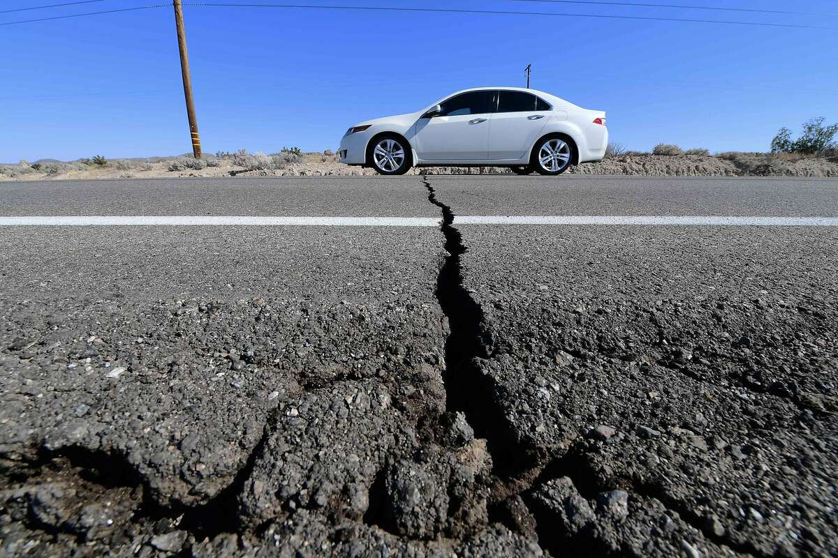 A car drives past a crack in the road after a 6.4-magnitude earthquake in Ridgecrest, California, on July 4, 2019. - Southern California was rocked by a 6.4-magnitude earthquake Thursday morning, the US Geological Survey said, with authorities warning that the temblor, the largest in two decades, might not be the day's last. (Photo by FREDERIC J. BROWN / AFP)FREDERIC J. BROWN/AFP/Getty Images