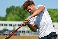 Jovani Wiggs swings a baseball bat at Shaker High School on Friday, June 28, 2019 in Latham, N.Y. Wiggs is recovering from a broken leg suffered in football season and plays baseball in summer. (Lori Van Buren/Times Union)
