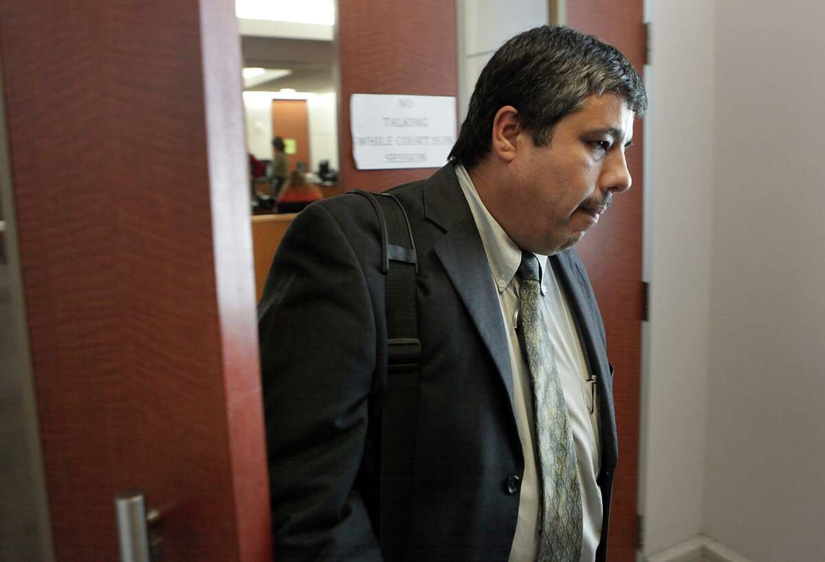 Javier Limon walks out of the 315th District Court in Houston where he is testifying during custody hearings against his daughter, Stephanie Limon Martinez, and custody of her children. Monday, Dec. 3, 2012. Casie Gotro, Stephanie's lawyer, is at left.