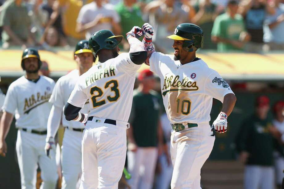 OAKLAND, CALIFORNIA - JULY 04: Marcus Semien #10 of the Oakland Athletics celebrates with Jurickson Profar #23 after hitting a grand slam in the bottom of the eighth inning against the Minnesota Twins at Ring Central Coliseum on July 04, 2019 in Oakland, California. (Photo by Lachlan Cunningham/Getty Images) Photo: Lachlan Cunningham / 2019 Getty Images