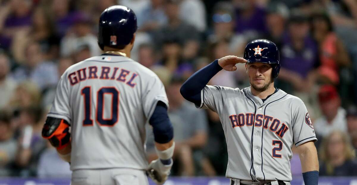 DENVER, COLORADO - JULY 02: Yuli Gurriel #10 of the Houston Astros is congratulated by Alex Bregman #2 as he crosses the plate after hitting a 2 RBI home run in the seventh inning against the Colorado Rockies at Coors Field on July 02, 2019 in Denver, Colorado. (Photo by Matthew Stockman/Getty Images)
