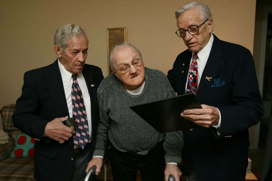 Nello Ceccarelli died at the age of 94 on Thursday July 29, 2010.  In 2007, Joe Gall, left, and Bill Varga presented Nello Ceccarelli with a medal and an honorary membership in the American Legion. Nello Ceccarelli served on the Representative Town Meeting for 55 years. Photo: B.K. Angeletti / Connecticut Post Freelance