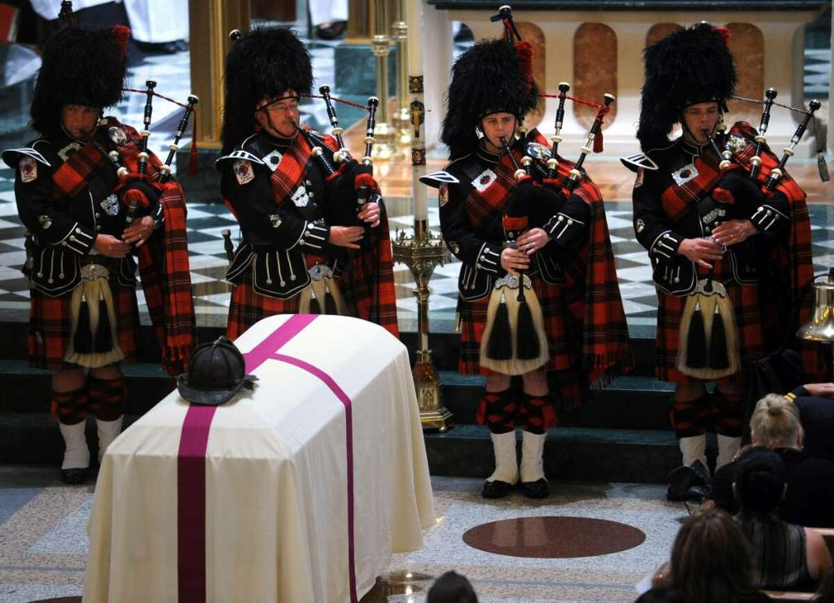 Bagpipers play during funeral services for Bridgeport Firefighter Lt. Steven Velasquez at St. Augustine Cathedral in Bridgeport Friday July 30, 2010. Velasquez died in a fire last Saturday.