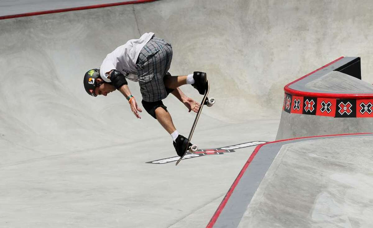 LOS ANGELES, CA - JULY 30: Andy Macdonald performs during the Skateboard Park Elimination at the Event Deck at LA LIVE during X Games 16 on July 30, 2010 in Los Angeles, California. (Photo by Stephen Dunn/Getty Images) *** Local Caption *** Andy Macdonald
