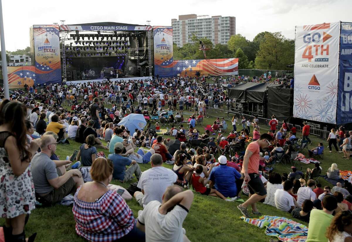Attendees fill the Buffalo Bayou Park while Kelly Pickler performs during CITGO Freedom Over Texas festival on Thursday, July 4, 2019 in Houston.