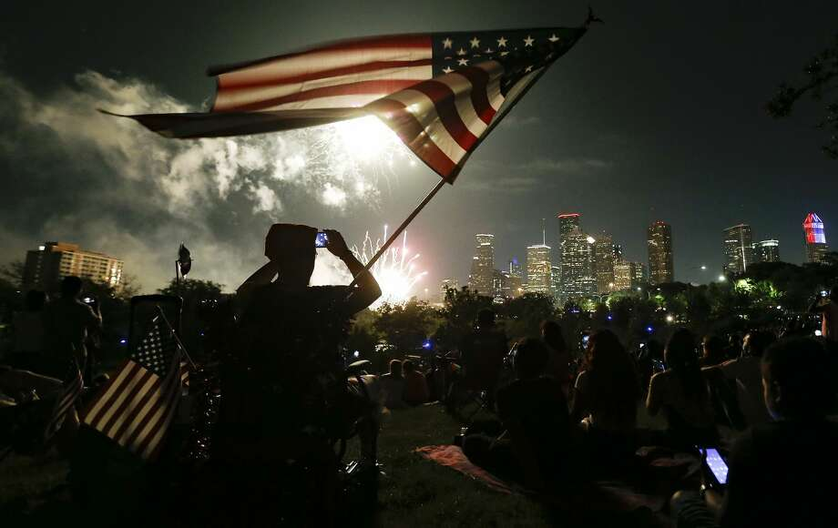 FOURTH OF JULY: Revelers bask in dry (but hot) weather during the Fourth of July, complete with firework celebrations across the city of Houston, by Zach Despart. Photo: Elizabeth Conley/Staff Photographer