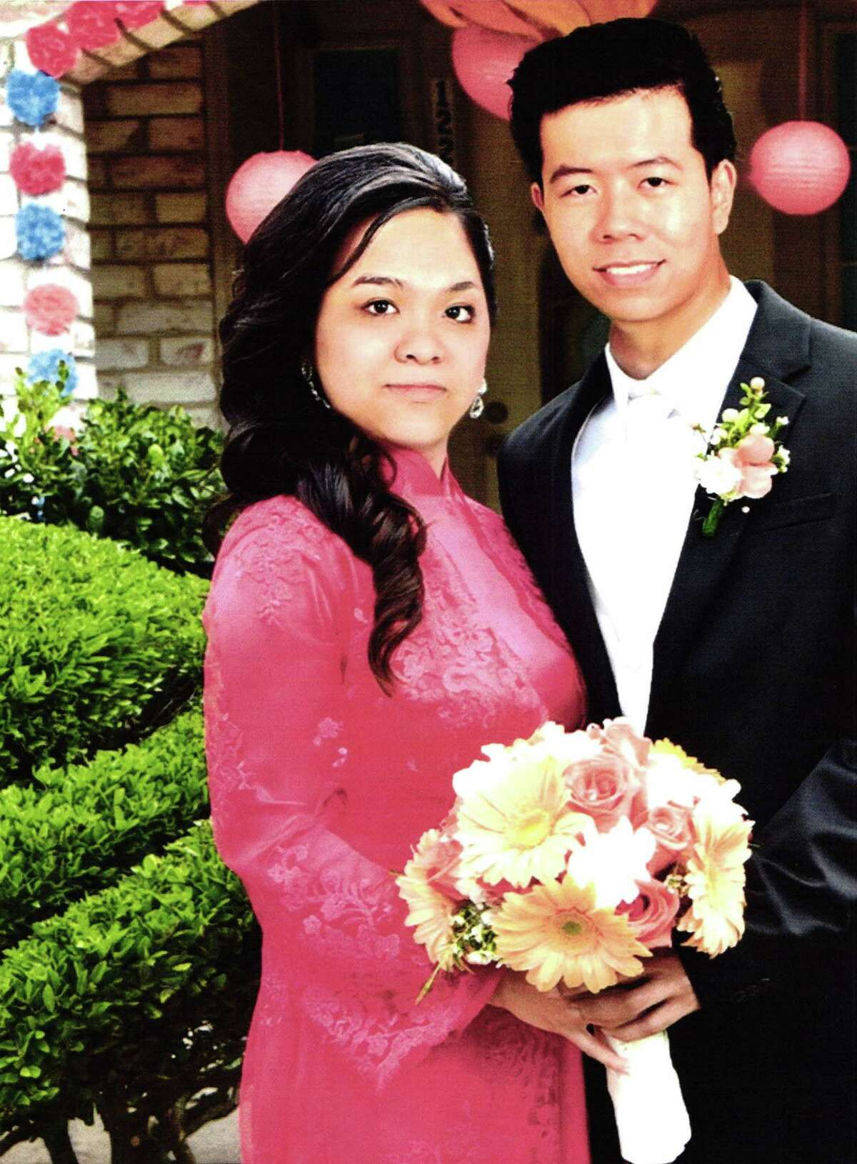 Photo from a wedding album of Khanh Phuong Nguyen and Tam Cong Le. Photo albums were submitted as evidence by federal prosecutors.