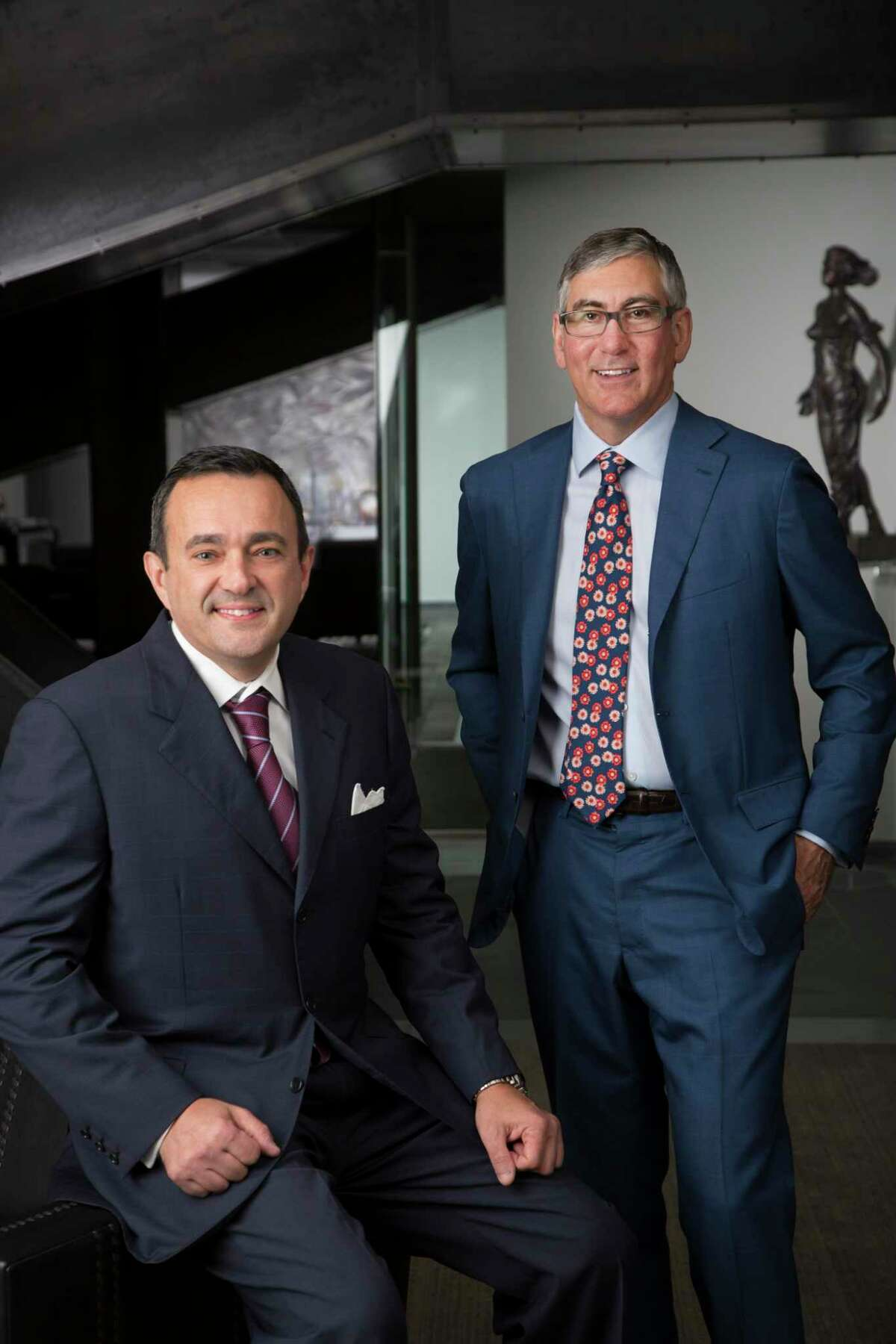 John Zavitsanos, seated, and Joe Ahmad, founding partners of Ahmad, Zavitsanos, Anaipakos, Alavi & Mensing. AZA was one of only two Texas-based law firms to make a list of elite law firms generating more than $1 million in revnues per lawyer.