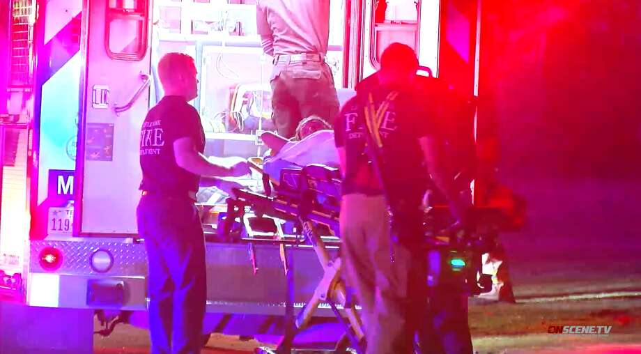 Harris County Sheriff's Office deputies respond to an accidental shooting Friday, July 5, after a 16-year-old girl was struck in the abdomen by a 12-gauge shotgun. Photo: OnScene TV