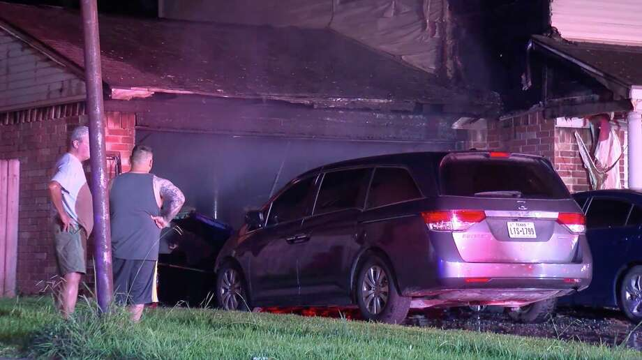 Atascocita firefighters tackle a fire at a home in the 19000 block of Yaupon Trail believed to be sparked by improperly discarded fireworks Thursday, July 4, 2019. Photo: OnSceneTV