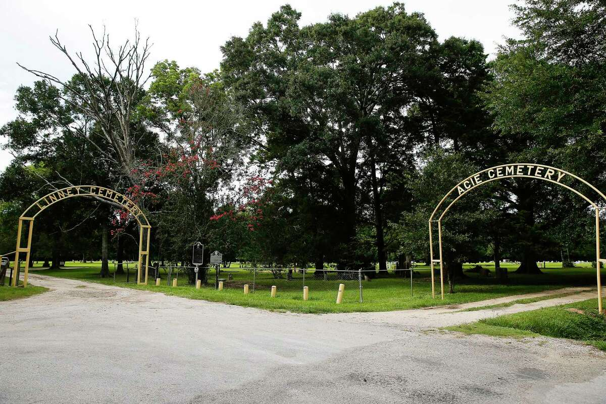 Entrances for the Linney and Acie cemeteries in Dayton, Texas on Tuesday, July 2, 2019. The two were separated by a fence and race until April 2019.