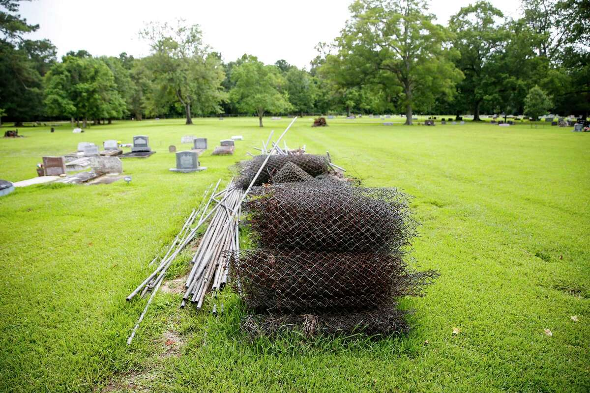 Remains of the fence that divided the Linney and Acie Cemeteries in Dayton, Texas are piled on the property on Tuesday, July 2, 2019.