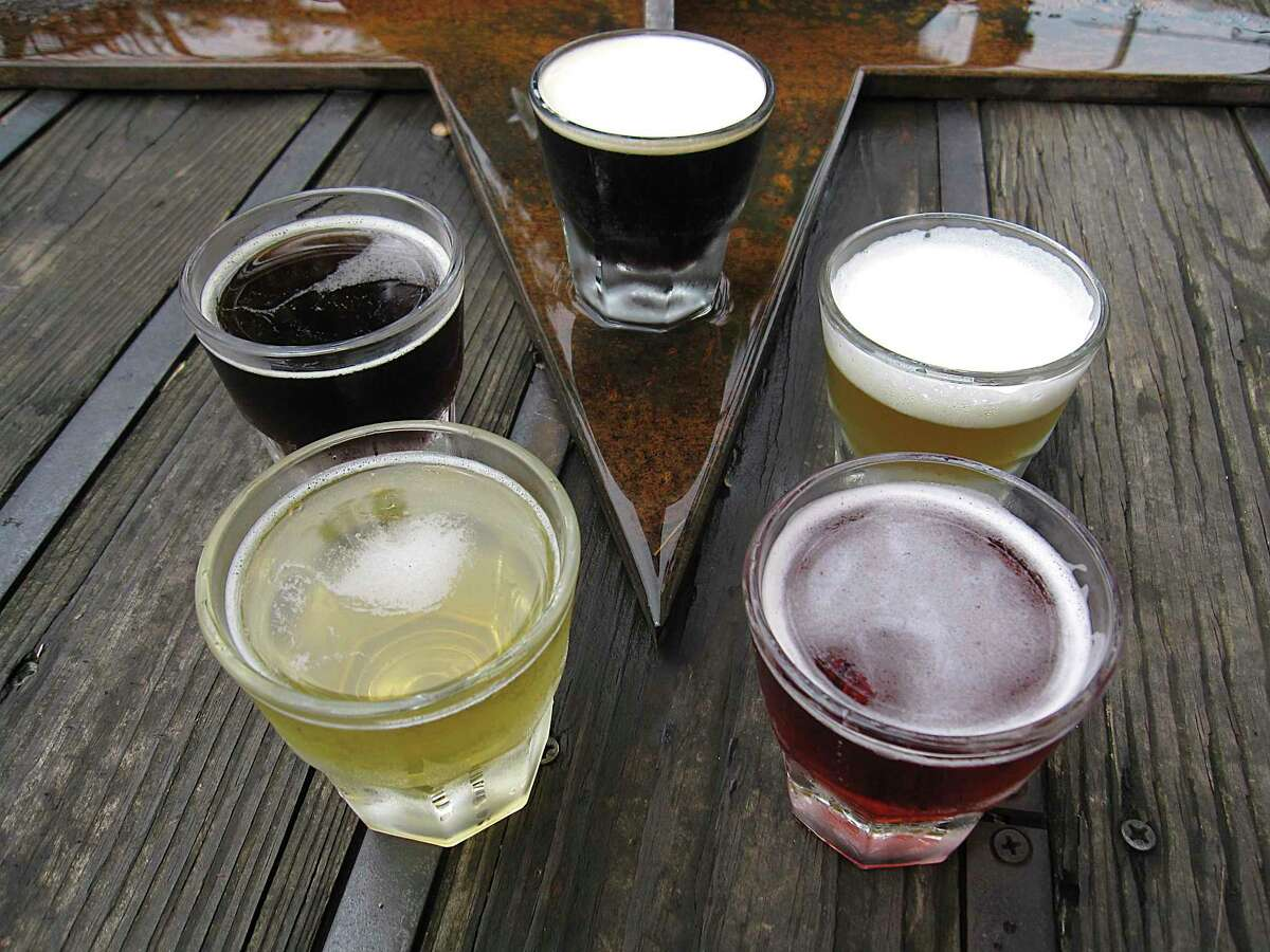 A sampling of housemade beers from Blue Star Brewing Co. includes, clockwise from top, Spire Stout, King William Ale barleywine, Raspberry Geyser sour, Texican Lager and Dunkelhead dark lager.
